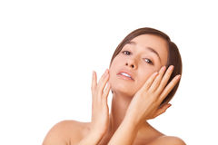Woman touching face Royalty Free Stock Images