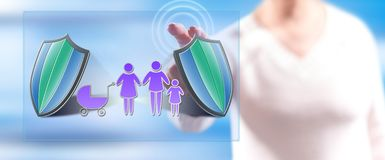 Woman touching a family insurance concept stock image