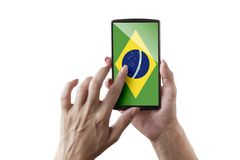 Brazil flagged screen. Woman is touching the flagged screen royalty free stock photography