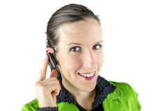 Woman touching the hands free placed at her ear Stock Photo