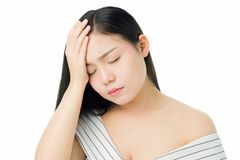 Woman touching head to show her headache. Causes may be caused by stress or migraine. Or because too much work. The concept of stress from hard work is bad for royalty free stock images