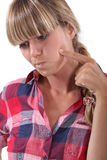 Woman touching her cheek Stock Image
