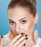 Woman touching her clean face. Bright manicure Stock Photo