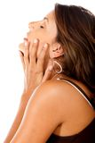 Woman touching her face Royalty Free Stock Images