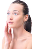Woman is touching her face Stock Image