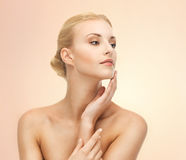 Woman touching her face Royalty Free Stock Photography