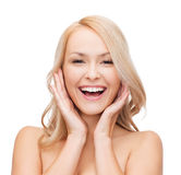 Woman touching her face skin Royalty Free Stock Image