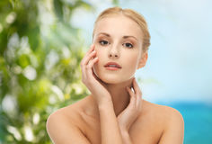 Woman touching her face skin Royalty Free Stock Images