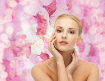 Woman touching her face skin Stock Image