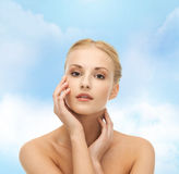 Woman touching her face skin Stock Photography