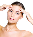 Woman touching her forehead Stock Photos
