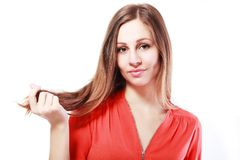 Woman touching her hair Royalty Free Stock Image