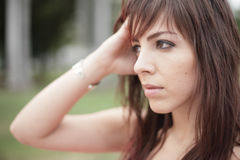Woman touching her head Stock Photography