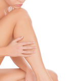 Woman touching her leg Stock Images