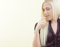 Woman touching her lips Royalty Free Stock Photography
