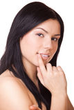 Woman touching her lips Stock Images
