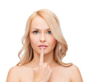Woman touching her lips Royalty Free Stock Photo