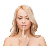 Woman touching her lips Stock Photography
