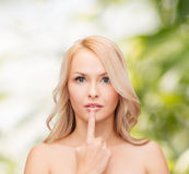 Woman touching her lips Stock Image