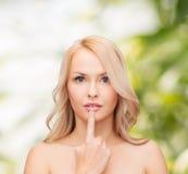 Woman touching her lips Stock Image