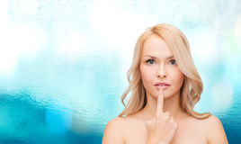 Woman touching her lips Stock Photo