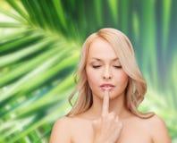 Woman touching her lips Stock Photos