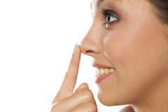 Woman touching her nose Stock Image