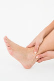 Woman touching her painful ankle Royalty Free Stock Photos