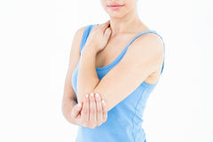 Woman touching her painful elbow Royalty Free Stock Photo