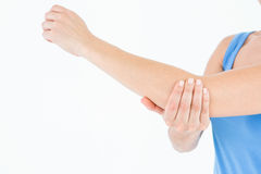 Woman touching her painful elbow Stock Image