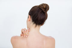 Woman touching her shoulder Royalty Free Stock Images