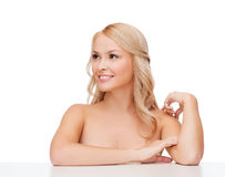 Woman touching her shoulder skin Stock Image