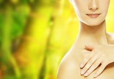 Woman touching her skin. Young beautiful woman touching her skin stock photos