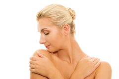 Woman touching her skin Stock Image