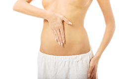 Woman touching her slim belly Stock Image