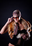 Woman touching her sunglasses Stock Photos