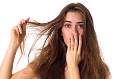 Woman touching her tangled hair Stock Photo