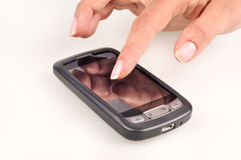 Woman touching with his finger blank smart phone Stock Photo