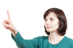 Woman touching an imaginary screen Royalty Free Stock Photos