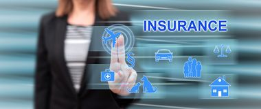 Woman touching an insurance concept. On a touch screen with her fingers stock images