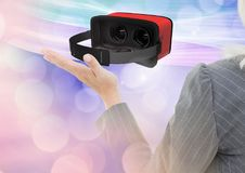 Woman touching and interacting with virtual reality headset with transition effect royalty free stock photo