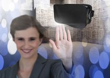 Woman touching and interacting with virtual reality headset with transition effect Stock Photos