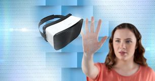 Woman touching and interacting with virtual reality headset with transition effect Royalty Free Stock Image