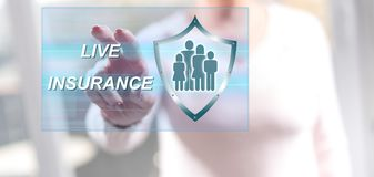 Woman touching a life insurance concept. On a touch screen with her fingers Stock Image
