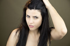 Woman touching long black hair Royalty Free Stock Image