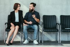 Woman touch man knee work harassment seduction stock image