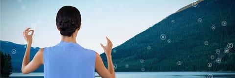 Woman touching nature interface. Digital composite of Woman touching nature interface Royalty Free Stock Image