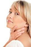 Woman touching neck Stock Photography