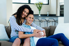 Woman touching pregnant partners stomach Royalty Free Stock Image