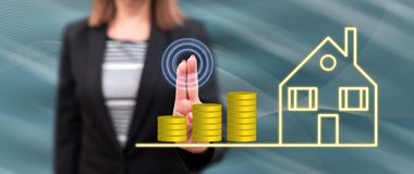 Woman touching a real estate investment concept stock images
